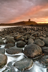 Happy New Year ... (Mike Ridley.) Tags: dunstanburghcastle dunstanburgh sunset pink orange nature seascape boulders embleton embletonbay sonya7r2 sony2470fegm mikeridley northumberlandcoast northumberland
