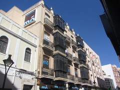 Balconies overlooking Plaza Mayor, Ciudad Real (d.kevan) Tags: buildings plazamayor ciudadreal streetlamps balconies architecturaldetails decorativedetails pinnacles railings glassedinbalconies