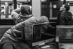 Apple (John St John Photography) Tags: streetphotography candidphotography 34thstreet subwaystation mta newyorkcity newyork pennstation commuters hoods apple monitor seated bench bw blackandwhite blackwhite blackwhitephotos johnstjohnphotography