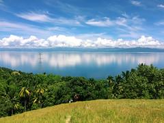 Mt. Lanaya, Alegria (blessygacasan) Tags: cebu philippines windowsxp mountainview reflection seaandsky skyblue greenfield