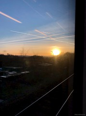 Sunset through a dirty window - Trans Pennine Express, signal stop at Huddersfield (mikeyashworth) Tags: mikeashworthcollection tpe transpennineexpress throughatrainwindow reflections settingsun lines patterns huddersfield sunset wintersday clearskies insidelookingout headinghome train trainwindow pennines dmu class185 siemens vapourtrails