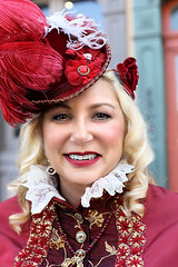 Beautiful Smile (wyojones) Tags: texas galveston dickensonthestrand holidayfestival hat dress blond hair girl lady lovely woman beautiful beauty feathers smile pretty curls lace red