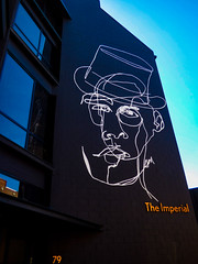 The Imperial (Steve Taylor (Photography)) Tags: theimperial 79 hat scribble drawing portrait sign building black blue white orange contrast man newzealand nz southisland canterbury christchurch cbd city outline sky office