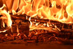 Pizza Oven Fire (Mikon Walters) Tags: oven fire pizza stone baked wood logs camp charred flames burning log macro photography nikon d5600 sigma 105mm lens close up detail shadows lighting flame