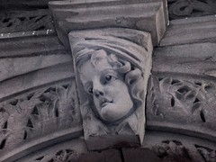 Wistful Gargoyle Face Above Doorway 4799 (Brechtbug) Tags: wistful gargoyle face above doorway building facade 25th street between 7th 8th avenues brownstone entrance nyc 11122018 new york city midtown manhattan 2018 gargoyles portraits monster portrait monsters creature faces spooky art architecture sculpture keystone mask brownstones brown stone