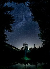 Milky Way through the trees (ramvogel) Tags: sony a6300 samyang 8mm crestasee tree night water reflection longexposure switzerland landscape astro