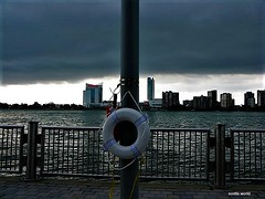 Drowning in debt (SCOTTS WORLD) Tags: adventure america architecture sky summer stormy skyline windsor clouds city camera canada ceasers water river riverfront detroit digital downtown 313 exploring michigan midwest motown motorcity morning urban usa unitedstates urbanexploring outdoors outside fun fence gloomy atmosphere nature lifepreserver metaphor casino canonpowershot
