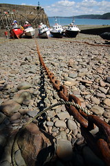 Securely moored (charliejb) Tags: clovelly northdevon devon 2017 harbour chains boats sea rocks pebbles