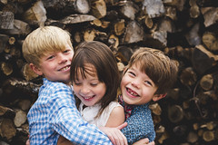 Just a little bit of love here (Elizabeth Sallee Bauer) Tags: nature bonding boy caring child childhood dressy family fancyclothes friends fun girl happiness hugging kid logs love outdoors outside playing qualitytime siblings together togetherness trees winter wood woodpile youth