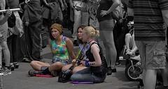 A Sit Down (Scott 97006) Tags: crowd street woman females ladies sitting pavement