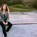 Girl Sitting at Skate Park Looking at Camera
