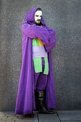 Jedi Joker cosplayer at ExCeL London's MCM Comic Con, October 2018 (Gordon.A) Tags: london docklands excel excellondonexhibitioncentre mcm moviecomicmedia comicbookconvention comiccon con convention mcm2018 october 2018 creative purple costume robe hood culture subculture style jedi joker villian supervillian dccomics cosplay cosplayer cosplayphotography festival event eventphotography model man face makeup pose posed posing wall outdoor outdoors outside amateur naturallight portrait portraitphotography colour colours color digital canon eos 750d sigma sigma50100mmf18dc