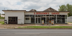 lindenow-1980-ps-w (pw-pix) Tags: ggrosvenorsgarage grosvenors garage servicestation shell petrol diesel fuel bowsers sign road street gravel forecourt grass naturestrip closed lines markings gutter kerb trres weeds sky clouds rural town country lindenow eastgippsland easternvictoria victoria australia peterwilliams pwpix wwwpwpixstudio pwpixstudio