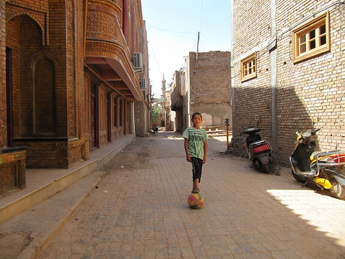 A boy practices soccer, Kashgar, Xinjiang, China