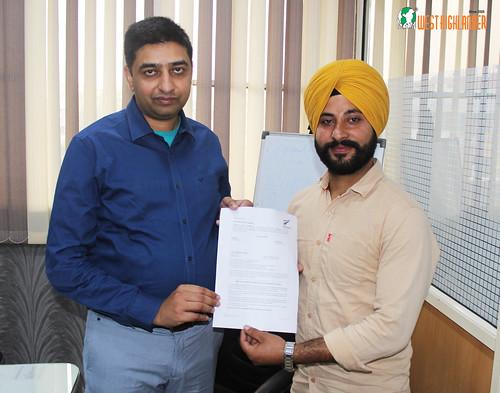 Mr. Gurvinder Singh (Director of West Highlander) handing over New Zealand Dependent Visitor Visa to Balpreet Singh
