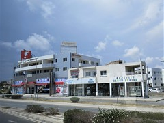 Commercial strip and sky, Eleftherias Avenue, Larnaca, Cyprus (Paul McClure DC) Tags: larnaca larnaka cyprus mediterranean may2018 architecture modern aradippou