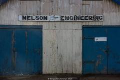 NELSON ENGINEERING (frattonparker) Tags: afsnikkor28300mmf3556gedvr btonner isleofwight lightroom6 nikond810 solent winter frattonparker shed workshop doors corrugated wrigglytin industrial marine bembridge harbour