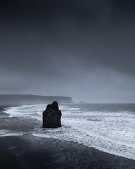 Weathered (Dan Portch) Tags: storm stormy reynisfjara beach dyrhólaey iceland winter rough sea seascape cliffs stack rock waves black vik moody drama dramatic seashore seaside
