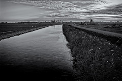 Some Things Never Change (Alfred Grupstra) Tags: nature landscape ruralscene outdoors sky sunset water river field scenics blackandwhite cloudsky grass agriculture farm nopeople summer europe dusk meadow