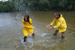 A yellow waterfight (50 pics) (sexyrainwear_dot_online) Tags: wellies rubberboots rainboots gummistiefel wetlook wetclothes friesennerz ostfriesennerz raincoat rainjacket rainmac rainwear raingear regenmantel regenjacke regnjakke regnjacka sadetakki ciré cire imper imperméable impermeable chubasquero capadechuva レインコート 비옷 regntøj