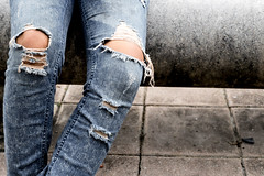 Torn jeans (bobmendo) Tags: lace retrostyled fashion women females plank fashionmodel jeans pants youngadult adult backgrounds oneperson concepts blue denim dirty oldfashioned old modern lifestyles closeup humanleg people casualclothing clothing deficiencies style hipster smartcasual fashionable