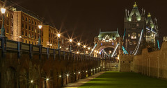Tower Bridge Approach (Vigor11) Tags: towerbridge toweroflondon night imposing eccentric tall bright london lamps light busstop underground buildings grass walls orange brown yellow street road blue aqua turret architecture symmetry leadinglines landscape
