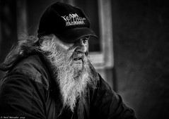 Its an old hat! (Neil. Moralee) Tags: neilmoralee neilmoraleenikond7200 man old mature beard age hat cap vkeeltkauf eltkauf street candid face portrait scraggy skruffy wild moustache black white bw bandw blackandwhite mono monochrome neil moralee nikon d7200 close destitute poor poverty germany ra extra