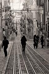 Caminantes (carlos_ar2000) Tags: gente people calle street vias railways linea line empedrado cobbled paisaje landscape lisboa portugal