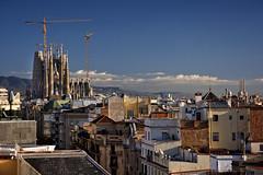 Barcelona skyline with Sagrada (Jamie B Ernstein) Tags: barcelona spain catalonia nikon architecture gaudi casamila sky skyline cathedral sagradafamilia blue cranes buildings sacral