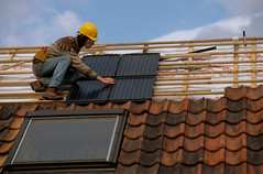 "Fitting Solar Panels 06 (hoffman) Tags: alternative architecture british britishisles builder building conservation construction ec eec efficiency electrical electricity employment engineer england english environmental eu europe europeanunion fitting fixing generating generation greatbritain hardhat helmet high horizontal house housing labor light male men panel photovoltaic power pv renewable renewableenergy roof science solar sun sunshine sustainable technology tiles uk unitedkingdom wires wood work worker working davidhoffman wwwhoffmanphotoscom davidhoffmanphotolibrary socialissues reportage stockphotos""stock photostock photography"" stockphotographs""documentarywwwhoffmanphotoscom copyright"
