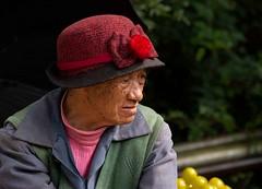 Naxi Woman (Rod Waddington) Tags: china chinese yunnan lijiang naxi minority portrait people woman hat outdoor ethnic ethnicity lemons streetphotography street