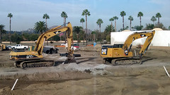 (Rich T. Par) Tags: pomona phillipsranch socal southerncalifornia losangelescounty lacounty constructionsite california palmtrees tree road suburb dirt civilengineering tubes excavator tractor heavyequipment pipes sky watertruck frontloader