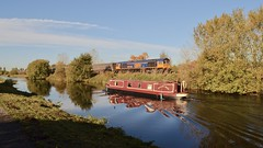 Railroads & Waterways (_J @BRX) Tags: canal barge narrowboat water reflection blue green gbrf november autumn 2018 class 66 crowle england uk locomotive freight train railway railroad rail electromotive diesel emd gm gbrailfreight nikon d5100 4r79 doncaster downdecoy immingham 66769 class66