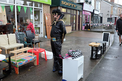 Working at the charity shop (kevin Akerman) Tags: charity shop elvis festival porthcawl chairs table