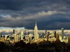 Dramatic lighting (pburka) Tags: esb empirestatebuilding midtown skyscrapers skyline nyc newyork sunlit clouds