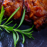 Baked meat with a rosemary thumbnail