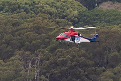 Search (armct) Tags: helicopter airborne rescue search ac139 westland valley currumbin goldcoast bulletin exhaust fumes nikon nikkor 200500mm telephoto zoom hillside missing 12500 rotor tail open cabin door hover altitude low agusta