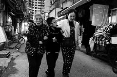 in search of homeland (Russell Siu) Tags: black white bw street candid family walking home lost despair longing sehnsucht desire generation grandma trio searching monochrome shanghai nanshi