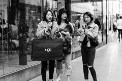 UGG (McLovin 2.0) Tags: girls candid shopping street streetphotgraphy urban city melbourne australia shop sony a7r zeiss 55mm bw monochrome