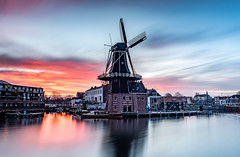 Sunrise at Molen de Adriaan (Aleem Yousaf) Tags: de adriaan haarlem molen deadriaan windmill netherlands nederlands skyline goedevrouwtoren goodwifetower spaarne henricus ruijsch verenigingdehollandschemolen tourist attraction travel water reflections architecture historic monument sunrise goldenhour glow fire adriaandebooys goevrouwetoren lock defence bridge pretty world outdoor digital camera nikon nikkor photography 2470mm neutral density filter long exposure d810 sky clouds downtown contrast history fun weather dawn europe restaurant