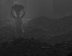 The Dark side of the Earth (ybiberman) Tags: varanasi india utterpradesh man working coal workers dust porter carry bowl barefoot people streetphotography candid bw