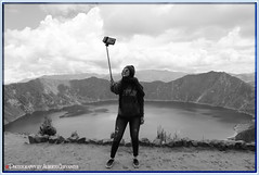 SELFIE, EL NUEVO RECURSO PUBLICITARIO. SELFIE, THE NEW ADVERTISING RESOURCE. COTOPAXI ECUADOR. (ALBERTO CERVANTES PHOTOGRAPHY) Tags: selfie monochrome blanconegro blackwhite blanco negro black white mujer girl miss lady autoretrato selfportrait autofoto face autophoto river lake sea ocean nubes clouds sky camera republicadelecuador cotopaxi andes ecuador andean cordilleradelosandes cordillera quilotoa people indoor outdoor blur luz light colors colores brightcolors bright streetphotography photoart photoborder photography colorlight montaña mountain creative oneself self myself lago quilotoalagoon lagoon lagunadequilotoa laguna señorita señora dama baby mrs babygirl cold