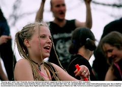 """Young girl with her friends during demonstration against the Cri (hoffman) Tags: activism adolescent british britishisles daylight demonstration earring ec eec energetic energy england english enlivened enthusiasm enthusiuastic europe female girl greatbritain happy horizontal joyful joyous juvenile lively london outdoors pierced piercing plaited plaits protest rebelling rebellion smiling street uk woman young youth davidhoffman wwwhoffmanphotoscom davidhoffmanphotolibrary socialissues reportage stockphotos""""stock photostock photography"""" stockphotographs""""documentarywwwhoffmanphotoscom copyright"""
