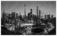 The Blue Hour - Central Park (GAPHIKER) Tags: newyorkcity blue hour bw tree people nyc centralpark central park iceskatingrink ice skating rink bluehour pano trump zamboni sunset 432parkavenue 111west57thstreet