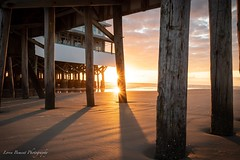 Under the Board Walk (lorenmb1) Tags: reflection sand sunstar sunrise florida daytonabeach pier boardwalk beach