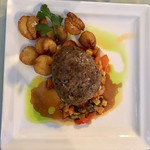 Steak dinner with sauce vegetables and potatoes thumbnail