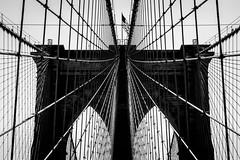 Bridge (John St John Photography) Tags: brooklynbridge easttower newyorkcity newyork photography streetphotography candidphotography americanflag architecture engineering civilengineering arches cables suspenders masonry bw blackandwhite blackwhite blackwhitephotos johnstjohnphotography highlights roebling bridge