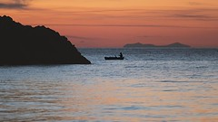 The man on the small boat (Oash_Dany) Tags: sunset ship boat italy calabria