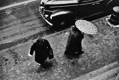 On a rainy day in Providence, Rhode Island, December 1940. (polkbritton) Tags: jackdelano fsaowi rhodeislandhistory streetphotography libraryofcongresscollections vintagefashion classiccars 1940s