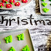CHRISTMAS written on flour with christmas cookie baking sheets around